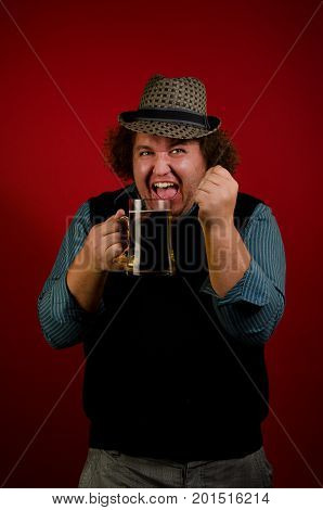 Happy fat man with beer. Red background.
