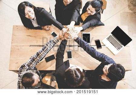 Top view business people group team happy showing teamwork and joining hands or giving five after meeting partner business in office. Business Concept