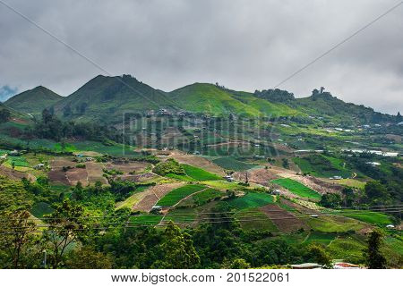 Mountains In The Clouds, The Villages And The Hills With Fields. Sabah, Borneo, Malaysia