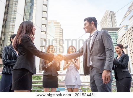 Businessmen shake hands to reach business agreement together Business concept Acheive concept