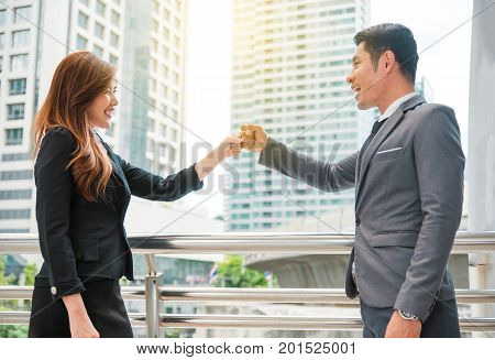 Businessman and businesswoman fist bump together Business concept Cooperate concept