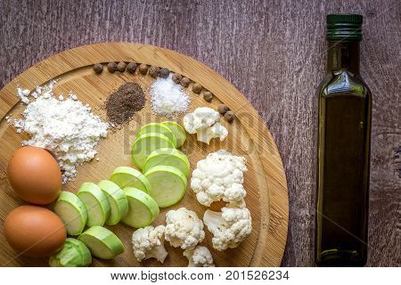 Fresh vegetables ready for roast. Top view. Wooden background. Copy space. Still life. Flat lay