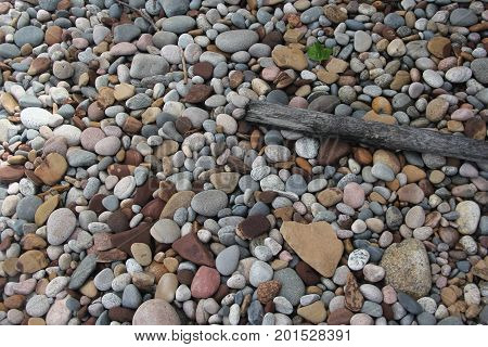 Rocks and stone filled beach.  Pictured Rocks National Lakeshore, Upper Peninsula of Michigan