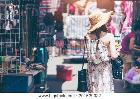 Young woman traveler is visiting at Mongkok in Hong Kong.