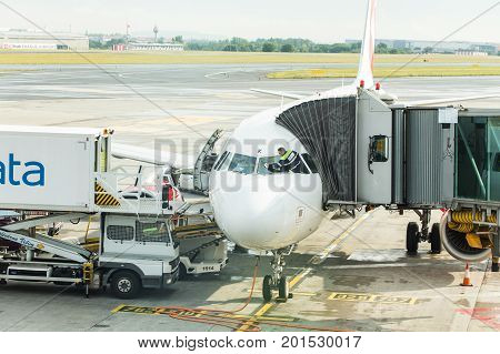 PRAGUE, CZECH REPUBLIC - JUNE 16, 2017: Vaclav Havel Prague International Airport, Ruzyne, Czech Republic. Loading luggage in the airplane.