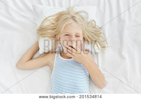Sleepy Girl Waking Up Early In Morning, Covering Mouth With Hand While Yawning, Going To School Or K