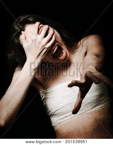 Horror shot: a terrible screaming monster woman. Grunge texture effect