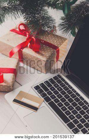Christmas online shopping. Making order for xmas on laptop with credit card. Winter holidays sales