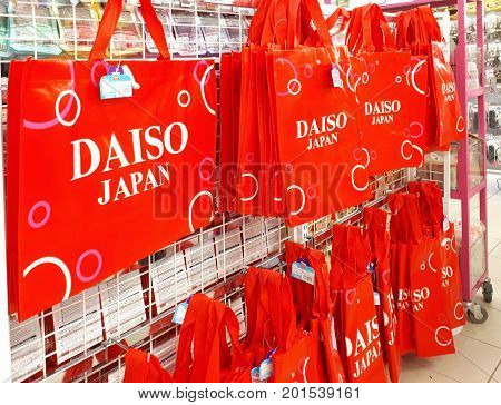 SHAH ALAM MALAYSIA - AUGUST 27 2017: DAISO brand red recycle shopping bag displayed for sale in DAISO store in SHAH ALAM. DAISO has 2800 stores in Japan and over 1850 stores in overseas.