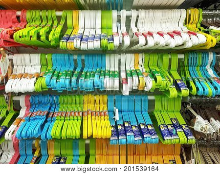 SHAH ALAM MALAYSIA - AUGUST 27 2017: DAISO brand multi-coloured plastic cloth hanger displayed for sale in DAISO store in SHAH ALAM. DAISO has 2800 stores in Japan and over 1850 stores worldwide.