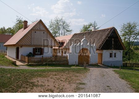 Rural homestead with saddle roof, farmyard and original decorative gate from the 19th century. Open Air Museum in Kourim Czech Republic