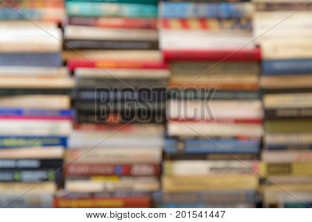 A stack of books with colorful covers. The library or bookstore. Books or textbooks. Education and reading. Unfocused image.