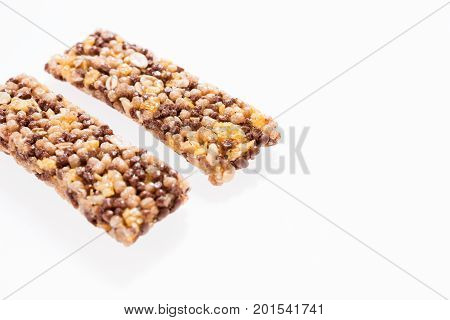 Two healthy granola bar (muesli or cereal bar) isolated on white background