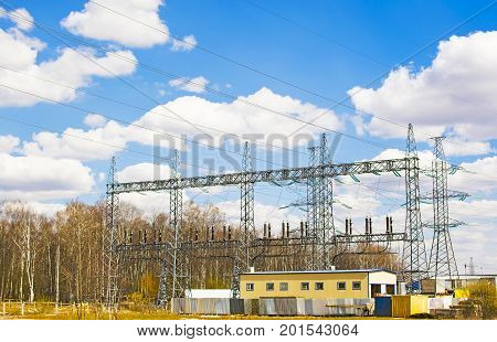 High voltage substations and outbuildings on the sky background