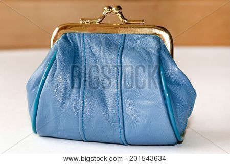 Purse for coins. Blue leather purse closeup