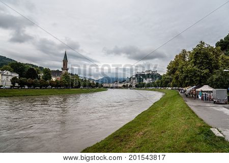 Salzburg Austria - August 6 2017: Scenic view of river in Salzburg. The Old Town of Salzburg is internationally renowned for its baroque architecture and was listed as a UNESCO World Heritage Site.