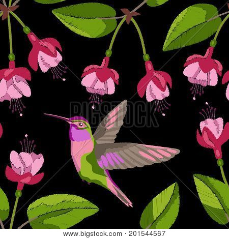 Pink fuchsia and hummingbird embroidery seamless pattern on black background. Romantic floral wallpaper, textile print.