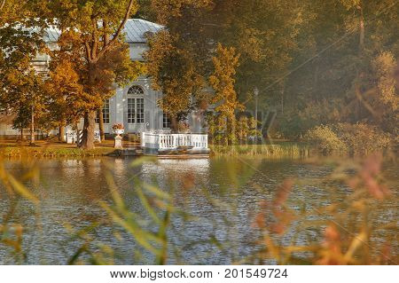 Pavilion Hall on the island with a dock on a large pond of Catherine Park in Pushkin, Tsarskoe Selo, St. Petersburg, autumn