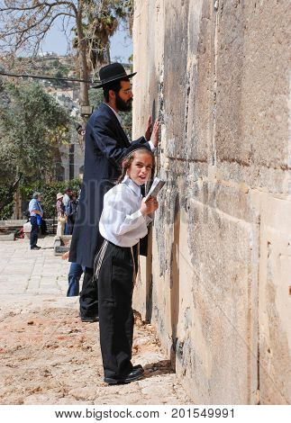 HEBRON ISRAEL - APRIL 12 2009: People pray next toTomb of the Patriarchs (Ma'arat HaMachpelah) in Hebron