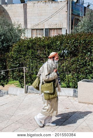 HEBRON ISRAEL - APRIL 12 2009: Undefined Orthodox jewish man walk toTomb of the Patriarchs (Ma'arat HaMachpelah) in Hebron