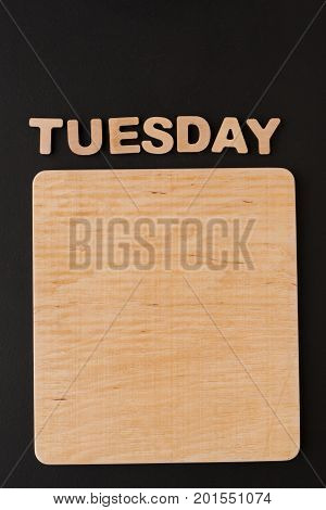 Word Tuesday with blank wooden board. Timetable, day of week, to-do-list, time management concept