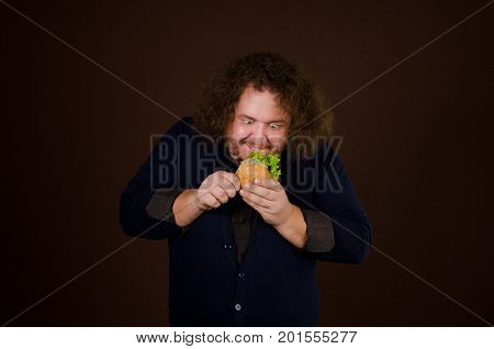 Hunger and dinner. Funny man with a hamburger. Food and hunger. Guy with burger. Healthy lifestyle and fast food.