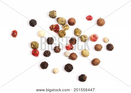 Mixed of peppers hot, red, black, white and green pepper isolated on white background. Top view.