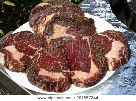 Pickled beef steak meat. Portioned meat. Raw fresh meat.Portioned meat prepared for processing for bbq