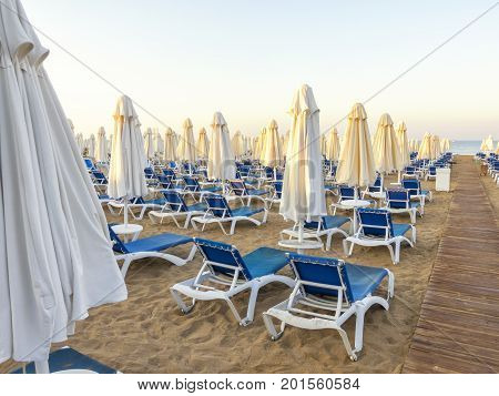 Sandy Beach To Sea With Wooden Footpath, Sun Beds, Umbrellas, Turkey, Side Resort