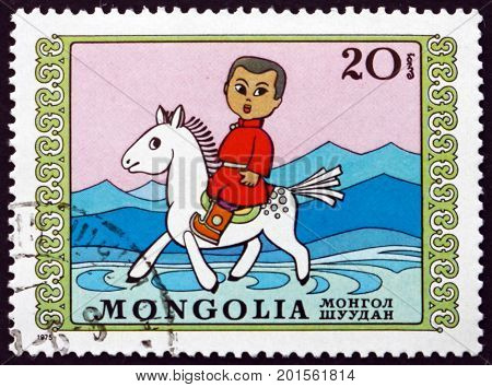 MONGOLIA - CIRCA 1975: a stamp printed in Mongolia shows Boy on Horseback Puppet Theater circa 1975