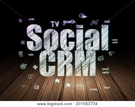 Marketing concept: Glowing text Social CRM,  Hand Drawn Marketing Icons in grunge dark room with Wooden Floor, black background