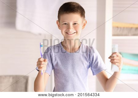 Cute little boy with toothbrush and paste at home. Cleaning teeth concept