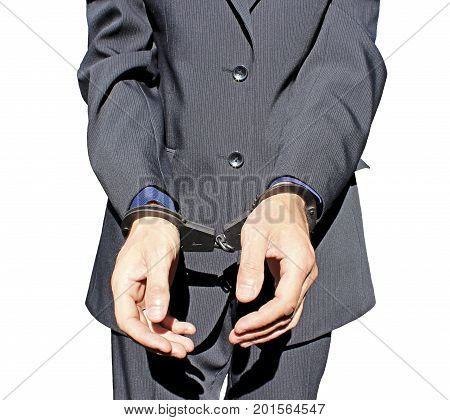 Man in black suit in handcuffs on his hands isolated on white background