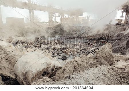Hot slag dump in metallurgical industry. Heavy industry plant shop.