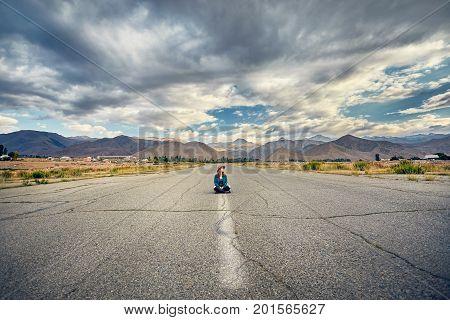 Beautiful Woman Sitting On The Road