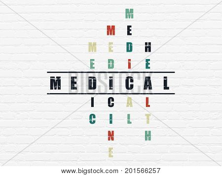 Health concept: Painted black word Medical in solving Crossword Puzzle