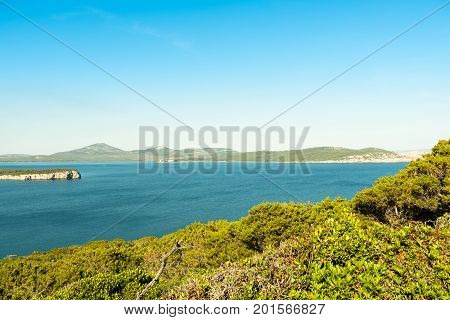 View the Spanish Tower and the beach Mare Pintau in Sardinia, Italy.