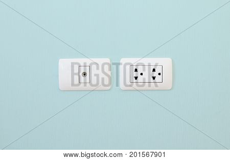 Electronic Plug and Television cable outlet on the blue wall