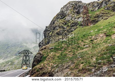 Car drive on the most famous and dangerous road in Europe is a Transfagarasan road in Carpathian mountains Romania.