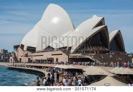 SYDNEY,NSW,AUSTRALIA-NOVEMBER 20,2016: Weekend crowds at the Sydney Opera House and Bar at Bennelong Point in Sydney, Australia