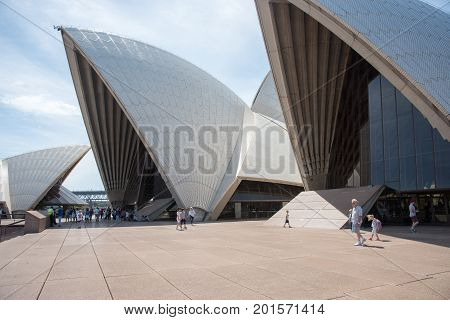 SYDNEY,NSW,AUSTRALIA-NOVEMBER 20,2016: Rooftop design with tourists at the Sydney Opera House under a blue sky with clouds in Sydney, Australia.