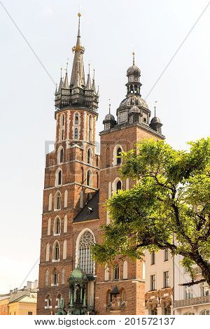 St. Mary`s Basilica at market square in Krakow (Poland)