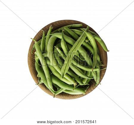 Fresh green beans in wooden bowl isolated on white background. Top view. Green beans with copy space for text.
