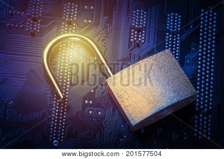 Opened padlock on computer motherboard. Internet data privacy information security concept. Blue toned image.