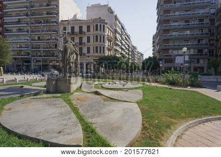 Thessaloniki, Greece - August 6 2017: Hagia Sophia square with statue day view. Agia Sophia square with homonymous pedestrian zone area in the city center.