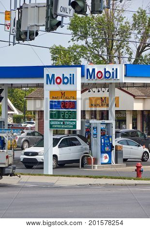 PLATTSBURGH USA - AUGUST 23 2017 : Mobil gas station with gas prices. Mobil is ExxonMobil's primary retail gasoline brand in California