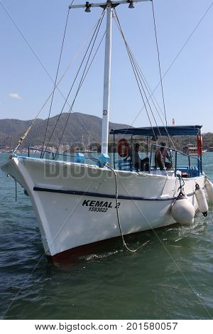 28TH JULY 2017,FETHIYE,TURKEY: A motor boat in the calm waters at calis,fethiye in turkey, 28th july 2017