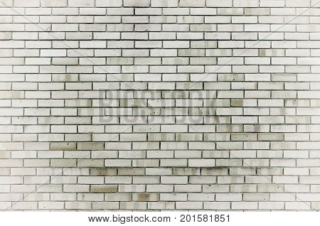 Stone wall texture background of grey brick stones. Stone wall texture with stone bricks. Closeup of stone wall background with grey bricks. Black and white stone wall background. Texture of stone wall