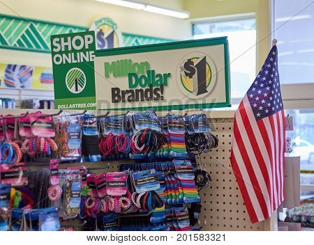 PLATTSBURGH USA - AUGUST 23 2017 : Dollar Tree shop online signage. with american flag. Dollar Tree Inc. is an American chain of discount variety stores that sells items for one dollar or less.