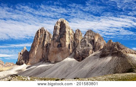 View of Drei Zinnen or Tre Cime di Lavaredo with beautiful cloud on sky Sextener Dolomiten or Dolomiti di Sesto South Tirol Dolomites mountains Italian Alps